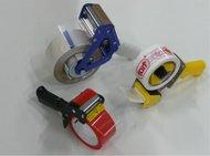 Manual adhesive tape dispensers